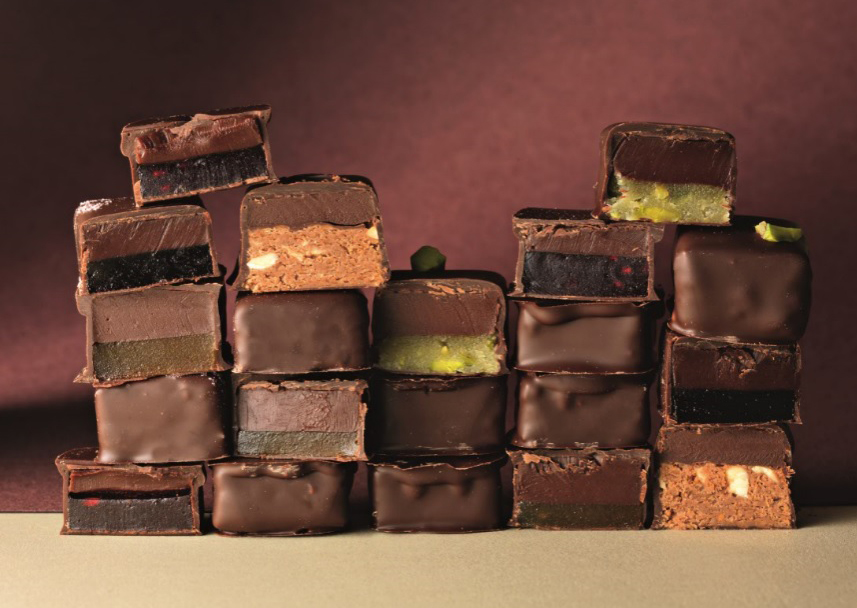 Couture Chocolare - Including, pistachio, Praline, Japanese Black Vinegar, Apricot & Wasabi, Juniper & Cassis and Raspberry.